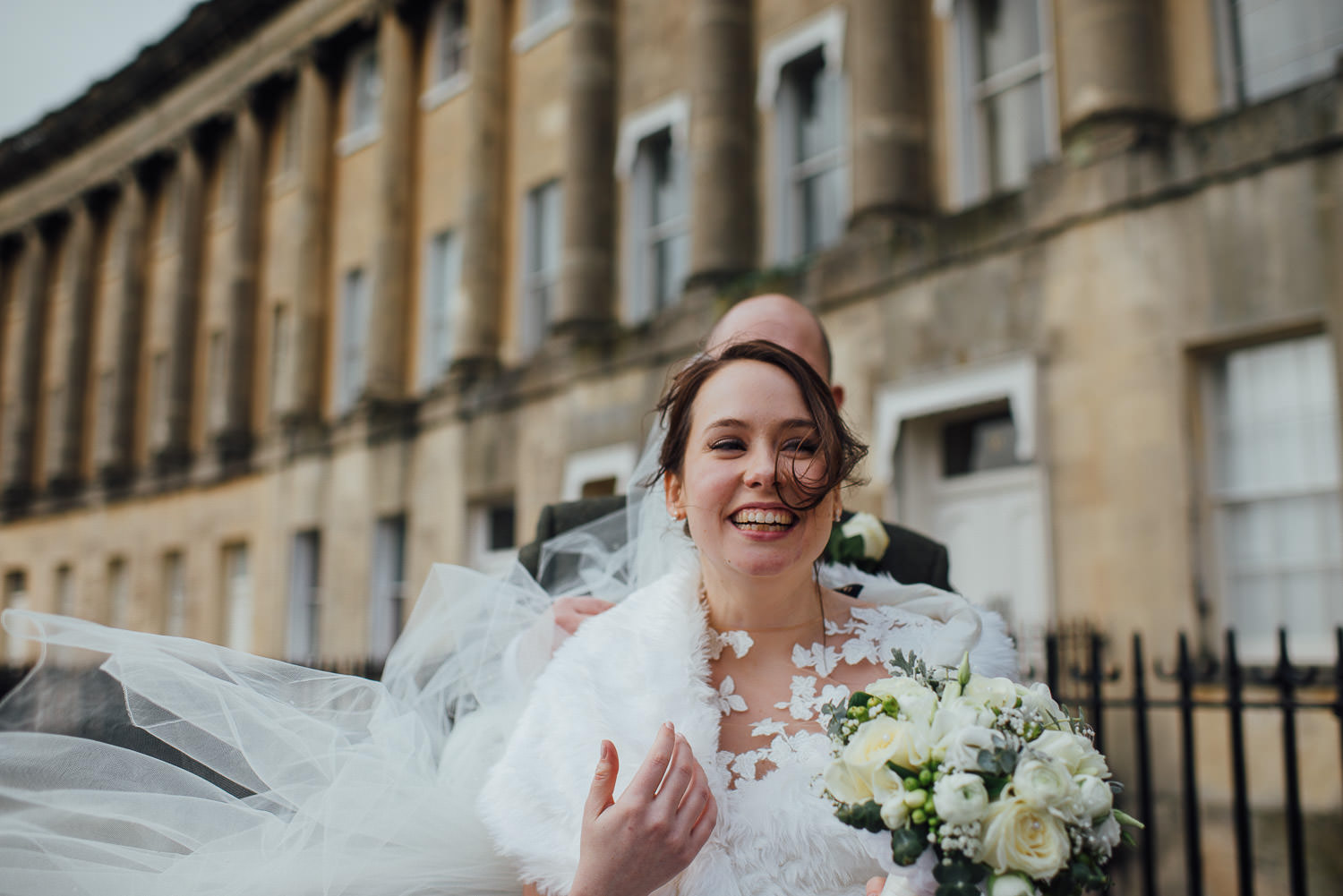 bride laughing outside the circle bath bath wedding photographer the shannons photography