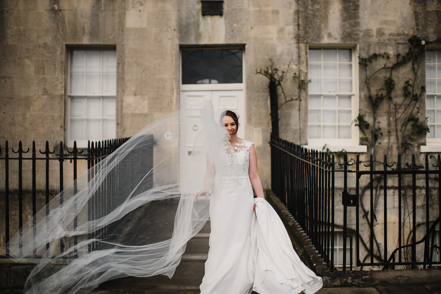 bride veil in the wind outside circus bath by bath wedding photographer the shannons photography