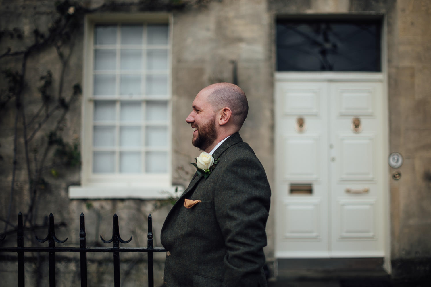 groom smiling at bride by bath wedding photographer the shannons photography