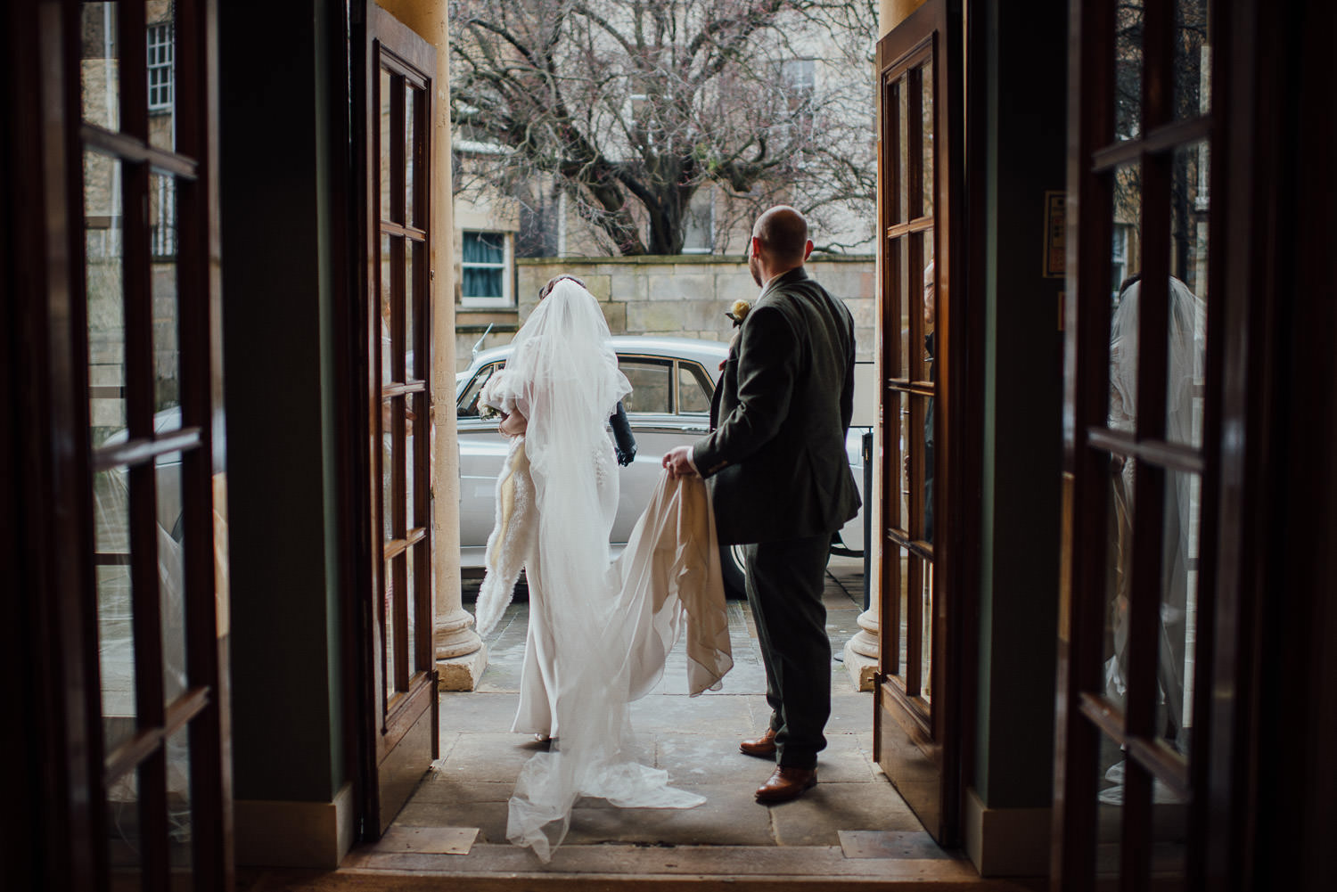 bride and groom entering the bath assembly rooms bath wedding photographer the shannons photography