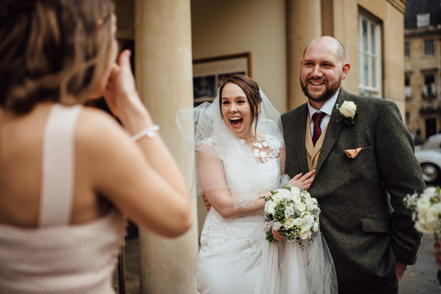 bride laughing at bridesmaid bath wedding photographer the shannons photography
