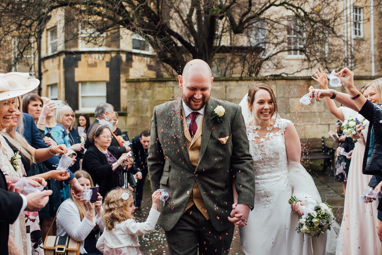 bride and groom smiling with confetti - alternative london wedding photographer the shannons photography