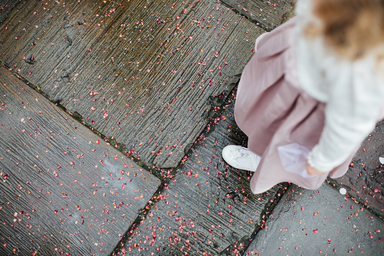 confetti on the ground by bath wedding photographer the shannons photography