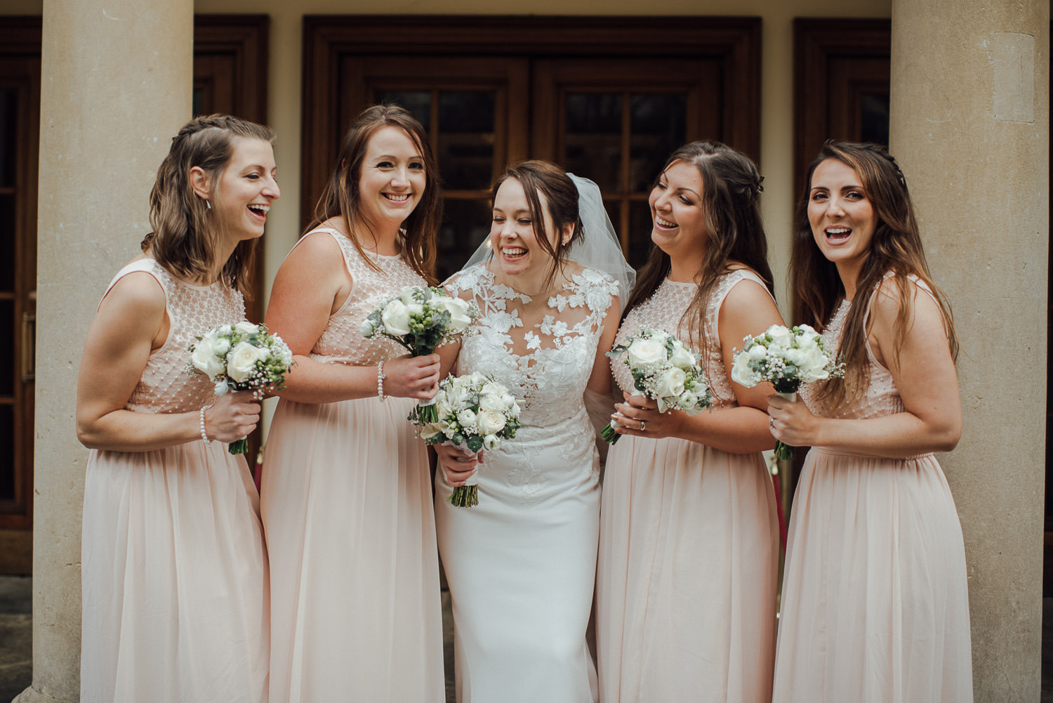 bridesmaids laughing outside the bath assembly rooms by bath wedding photographer the shannons photography