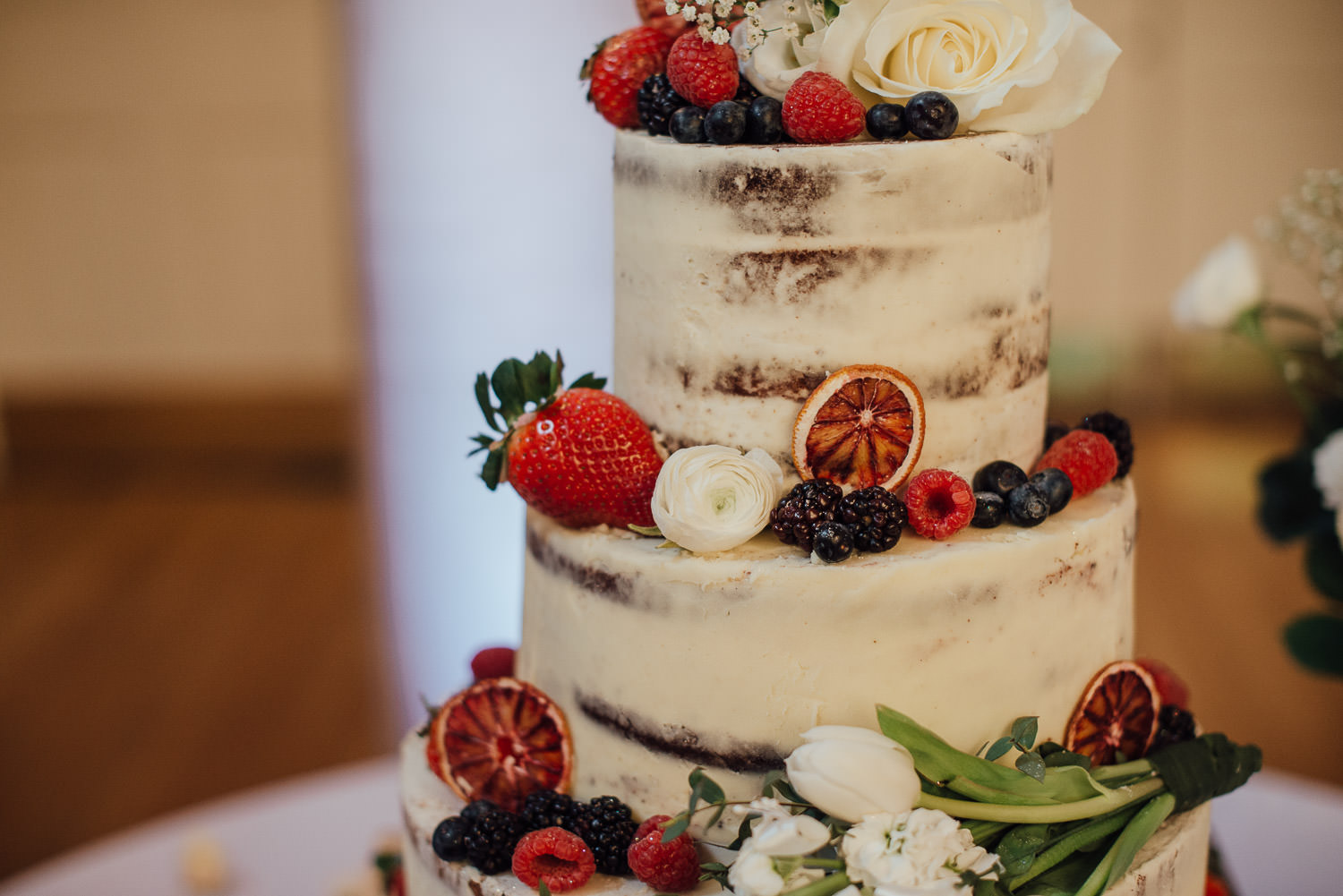 naked cake with fresh flowers by bath wedding photographer the shannons photography