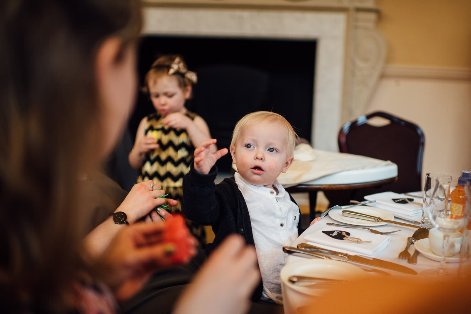 baby enjoying bubbles at wedding by bath wedding photographer the shannons photography