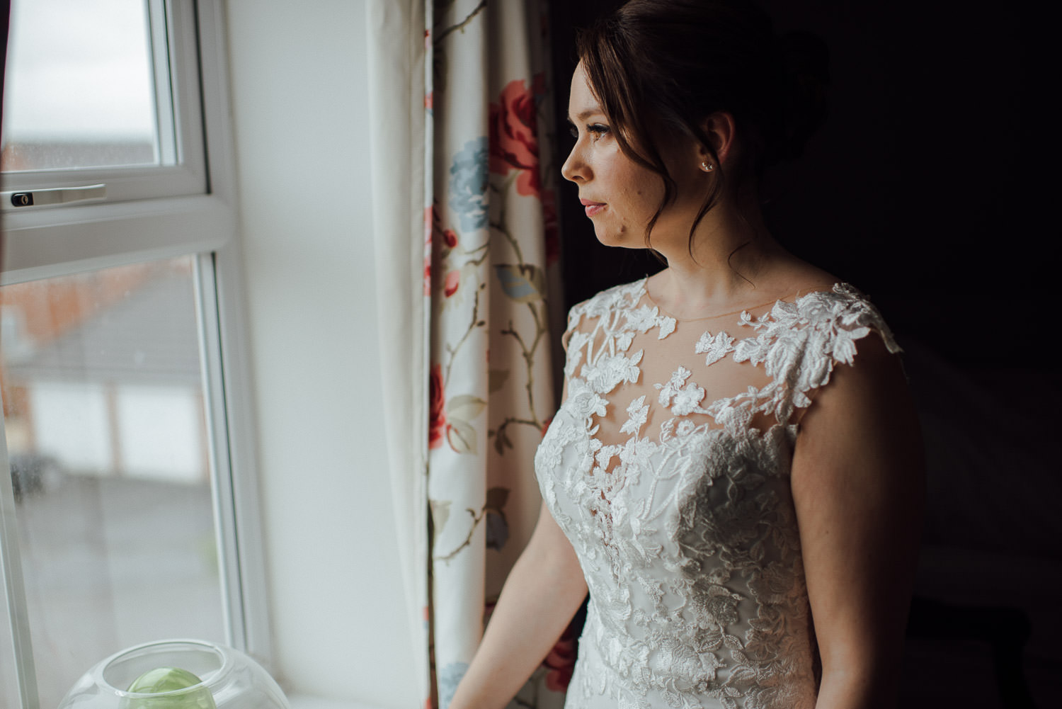 bath bride looking out of window by bath wedding photographer the shannons photography
