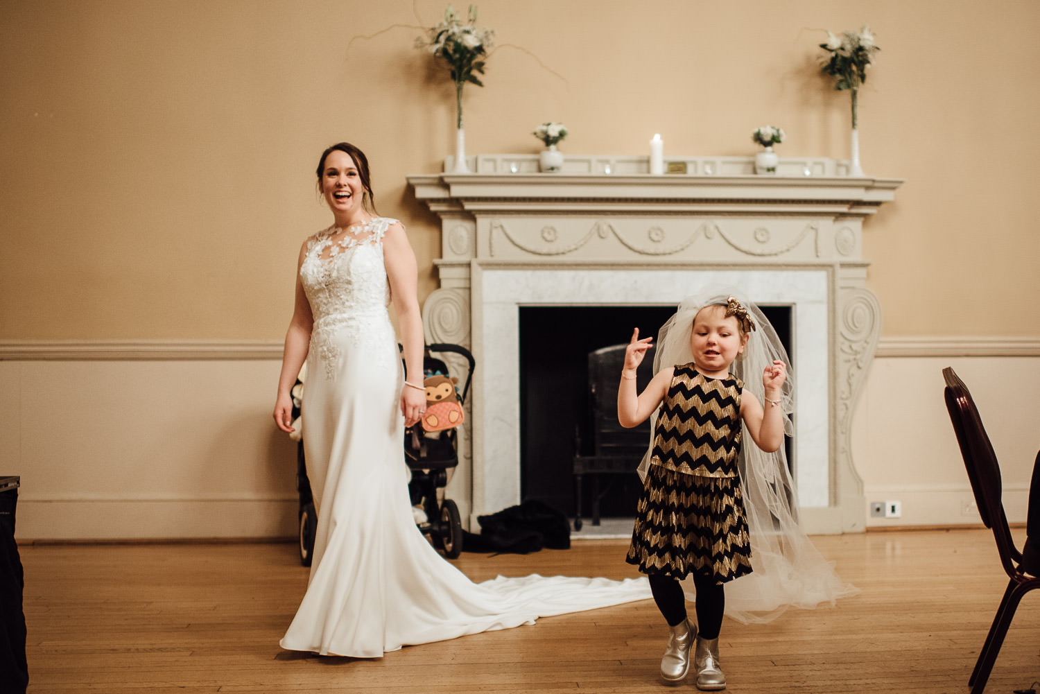 bride laughing a child guest wearing veil by bath wedding photographer the shannons photography