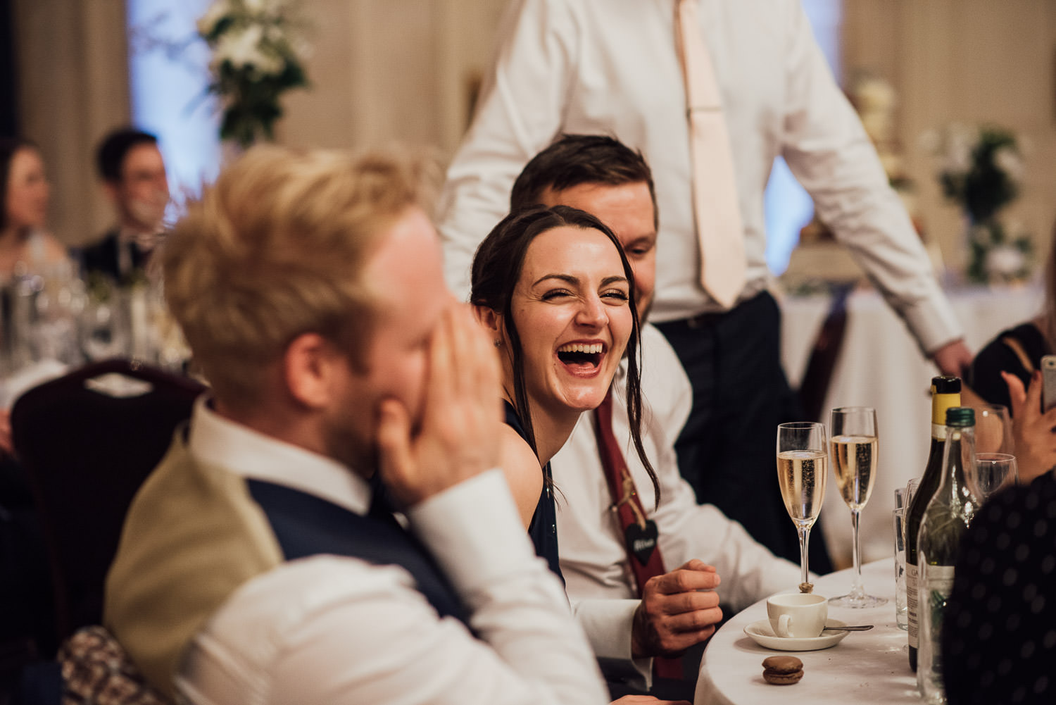 guests laughing during bath circus wedding by bath wedding photographer the shannons photography