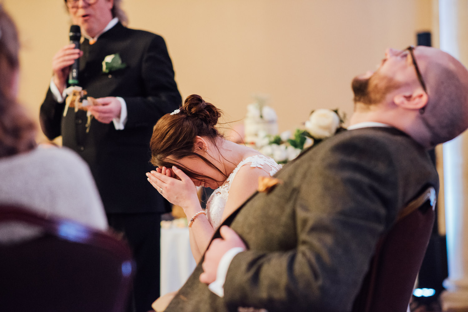 bride laughing at speeches by bath wedding photographer the shannons photography