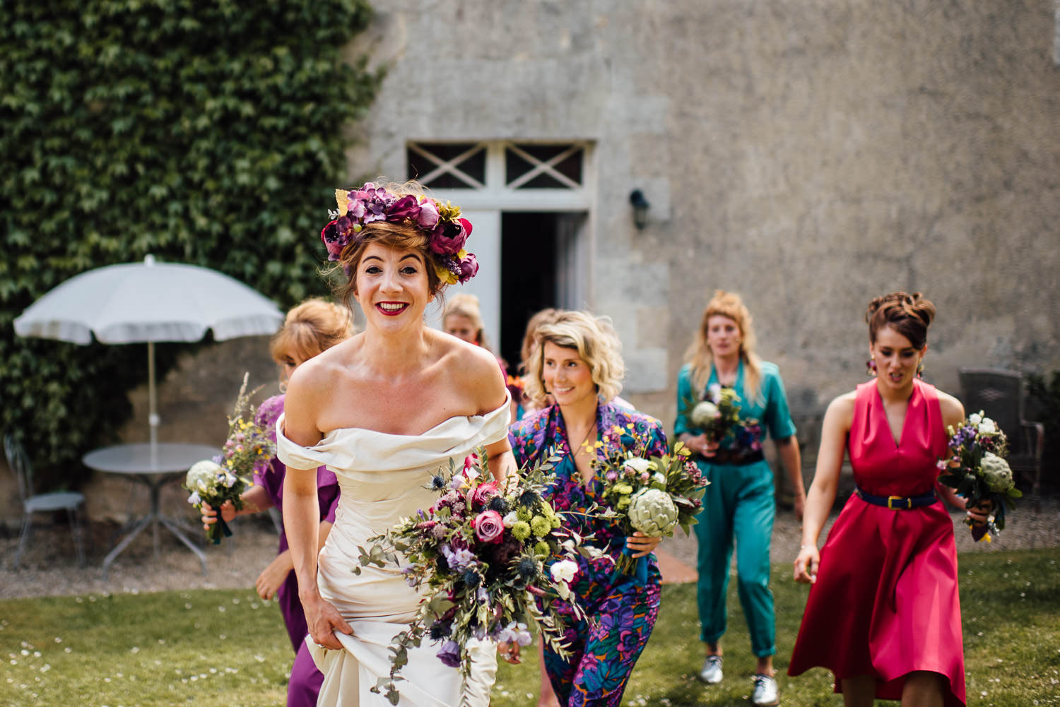 Bride walking in Bordeaux Chateau wedding by creative destination wedding photographer the shannons photography