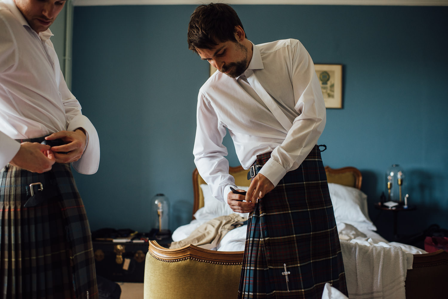 Groom putting on kilt in Barley Wood House Bristol Wedding by bristol wedding photographer the shannons photography