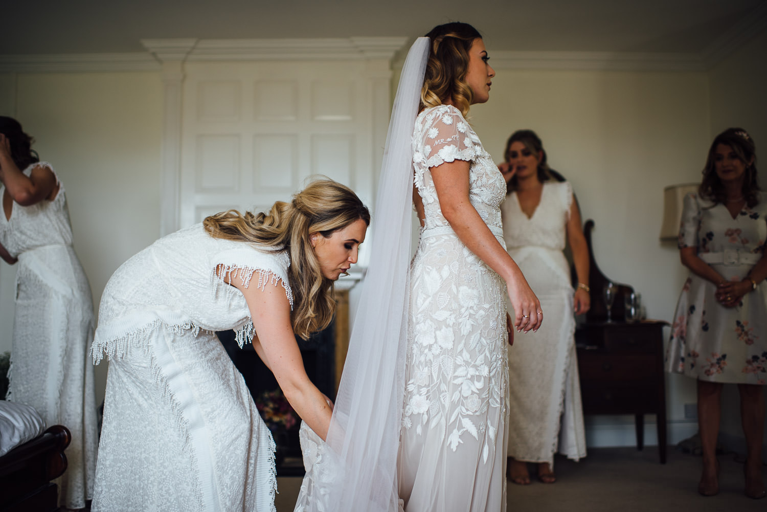 Bride putting on hermione de paula wedding dress
