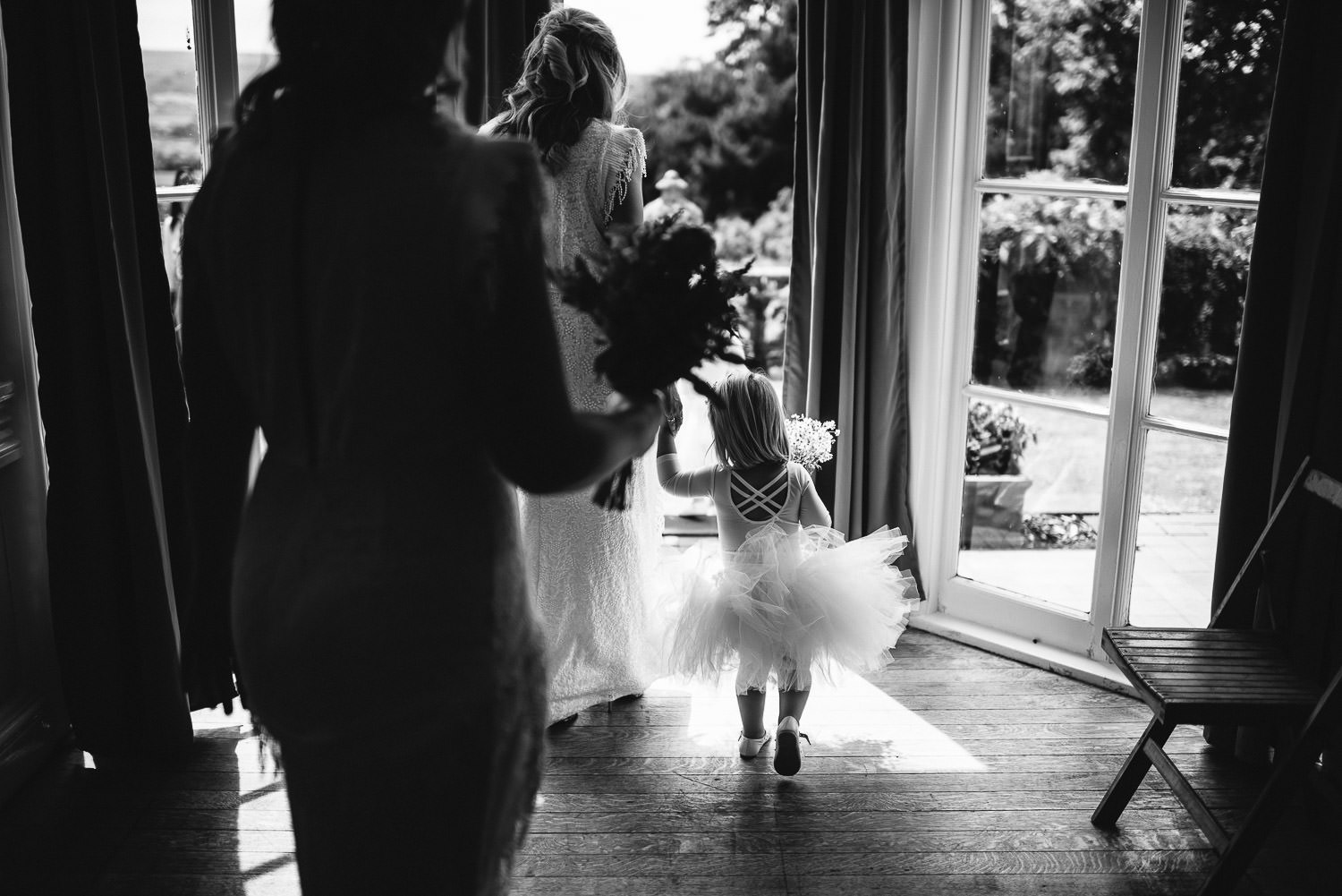 Flower girl tutu in Barley Wood House Bristol Wedding by bristol wedding photographer the shannons photography