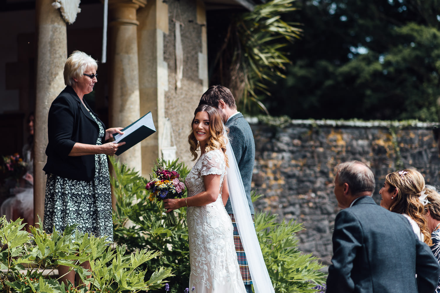 Exchanging vows in Barley Wood House Bristol Wedding by bristol wedding photographer the shannons photography
