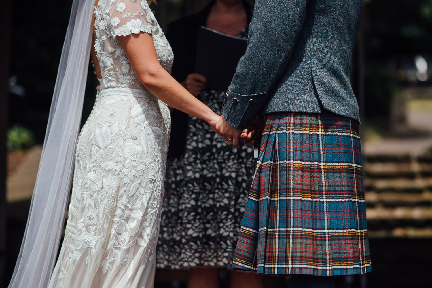 Groom in tartan in Barley Wood House Bristol Wedding by bristol wedding photographer the shannons photography