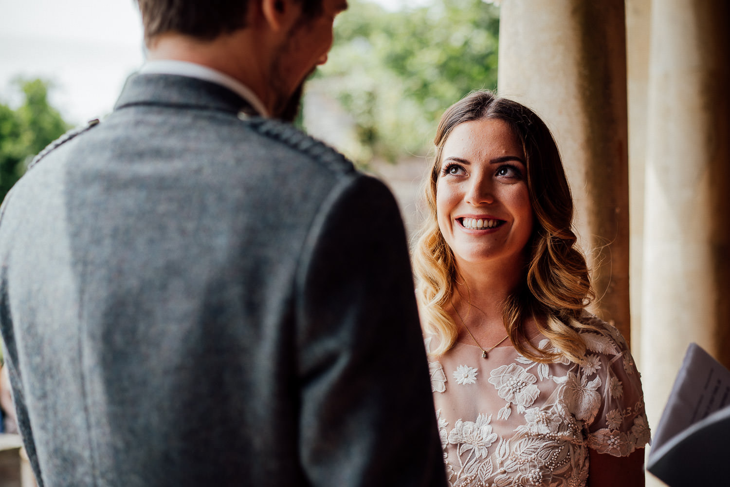 Bride and groom smiling in Barley Wood House Bristol Wedding by bristol wedding photographer the shannons photography