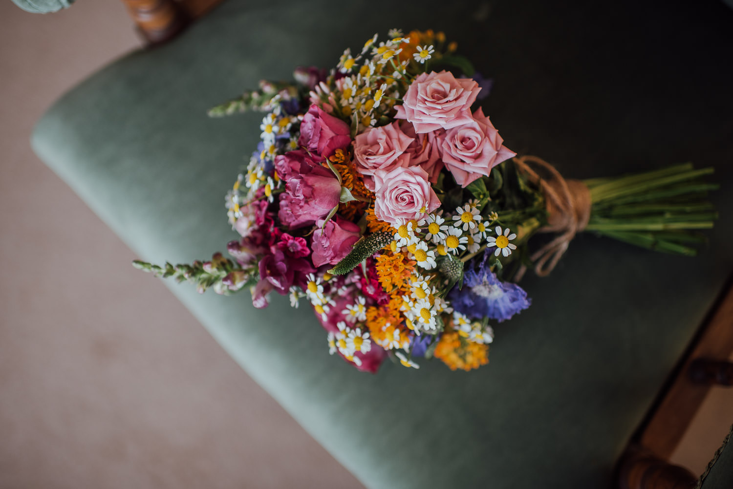 wildflower wedding bouquet in Barley Wood House Bristol Wedding by bristol wedding photographer the shannons photography
