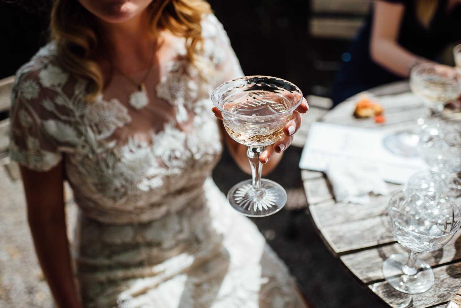 Vintage champagne glasses in Barley Wood House Bristol Wedding by bristol wedding photographer the shannons photography