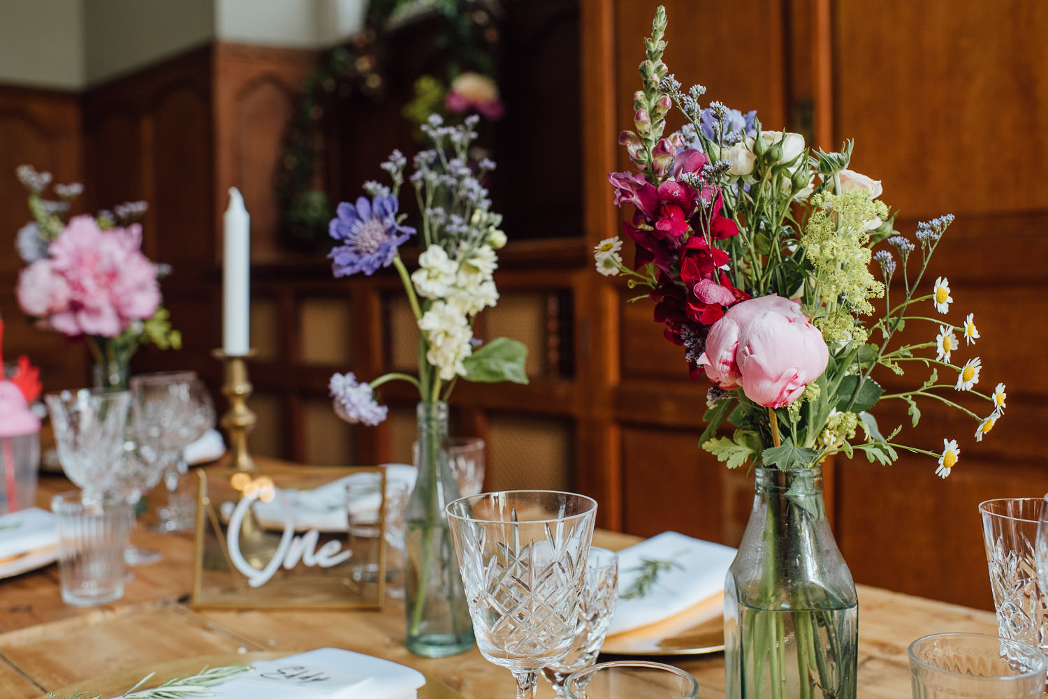 Wild flower table decorations in Barley Wood House Bristol Wedding by bristol wedding photographer the shannons photography