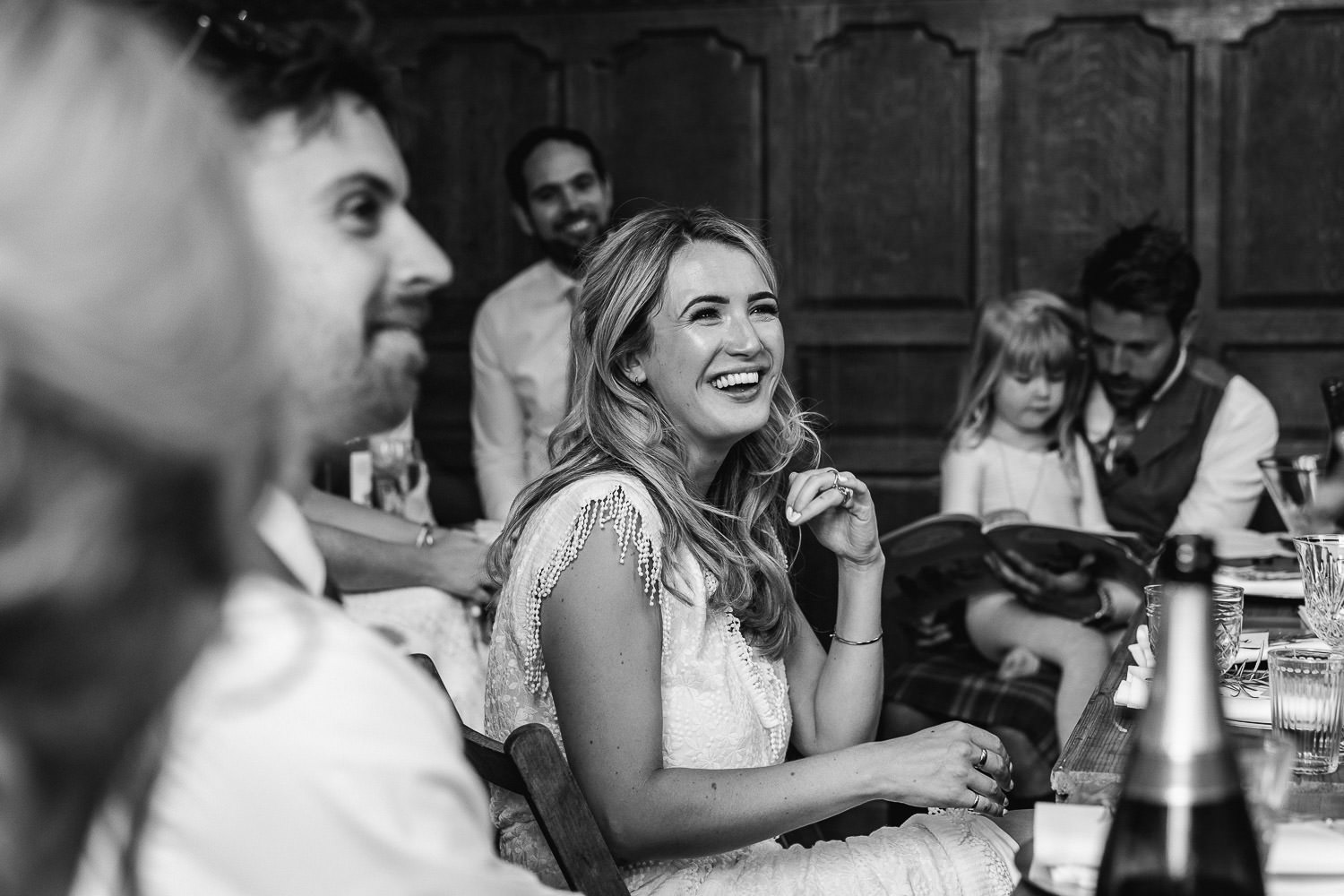 Bridesmaids laughing in Barley Wood House Bristol Wedding by bristol wedding photographer the shannons photography
