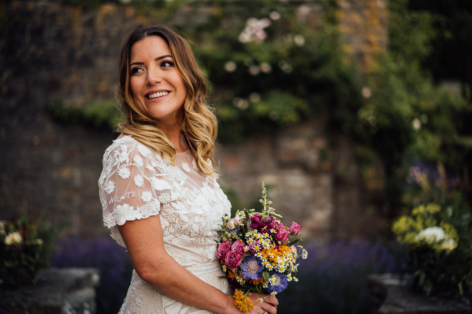 Bride looking in hermione de paula wedding dress in Barley Wood House Bristol Wedding by bristol wedding photographer the shannons photography