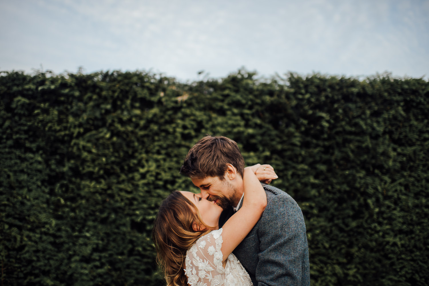 Bride and groom kiss in Barley Wood House Bristol Wedding by bristol wedding photographer the shannons photography