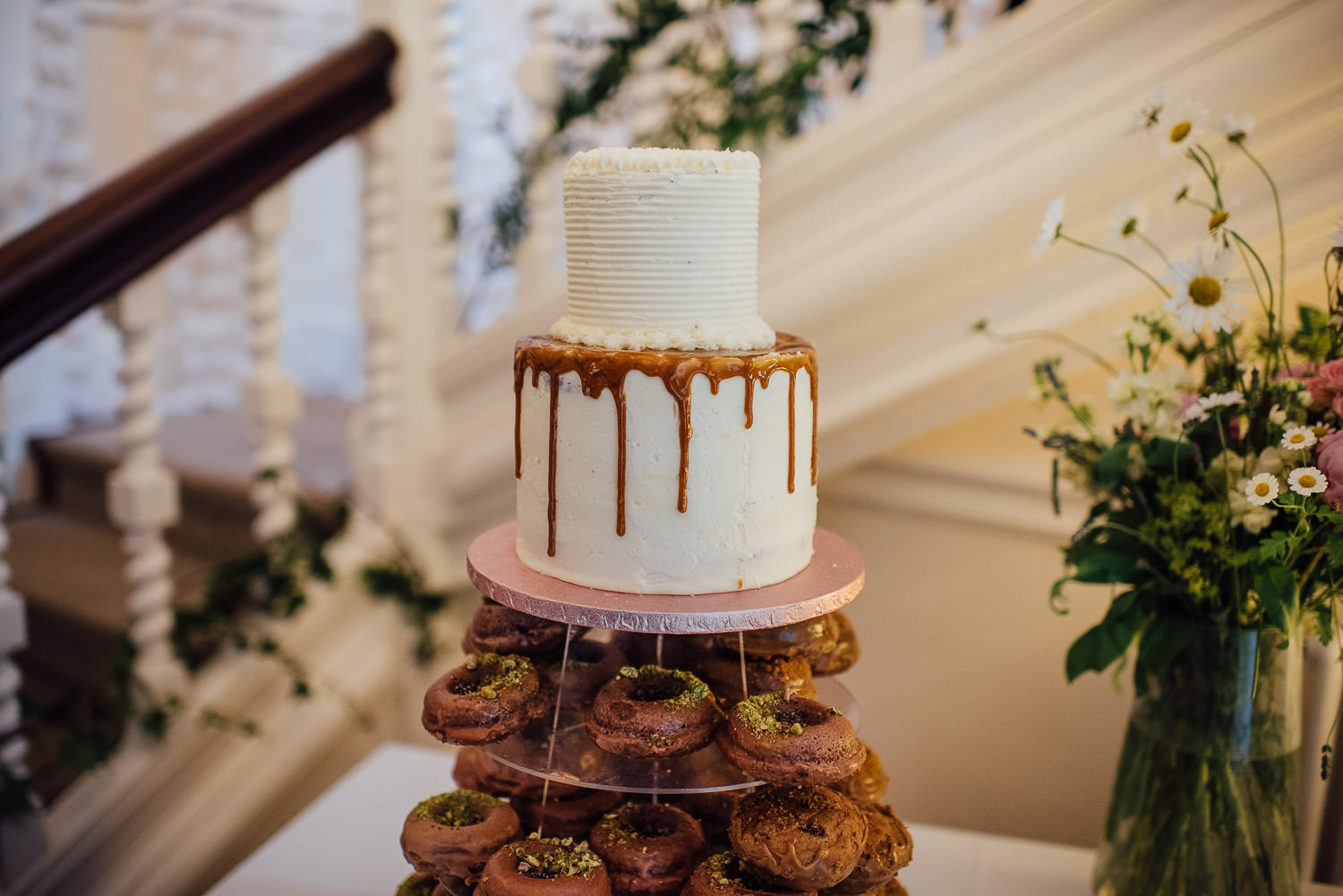 Doughnut wedding cake in Barley Wood House Bristol Wedding by bristol wedding photographer the shannons photography