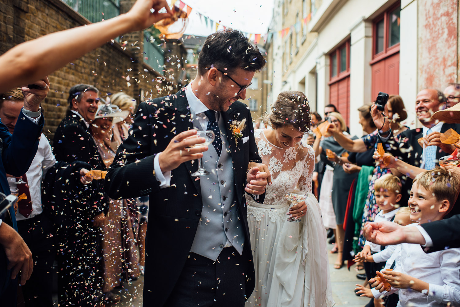 confetti throw wilton's music hall wedding by london wedding photographer the shannons photography
