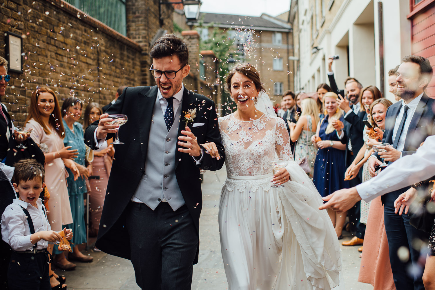 Wiltons music hall confetti in Wilton's Music Hall Wedding by london wedding photographer the shannons photography