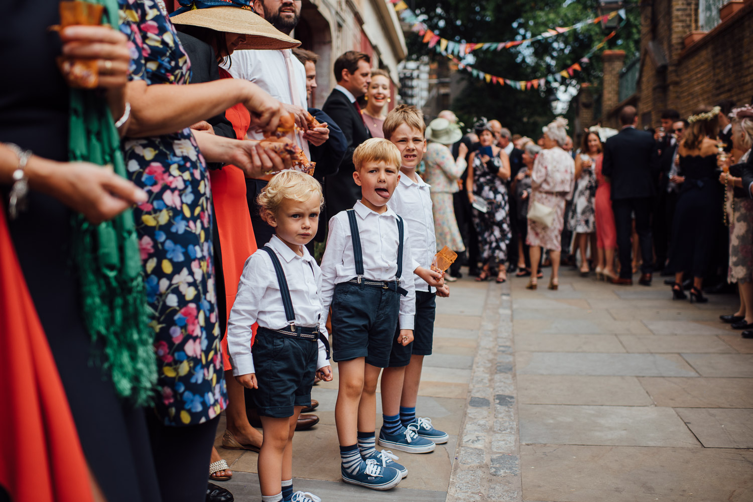 guests arriving wilton's music hall wedding by london wedding photographer the shannons photography
