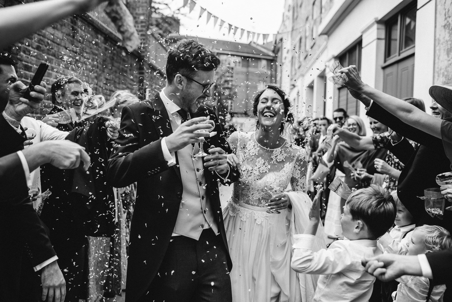 confetti throw in wiltons music hall wedding by london wedding photographer the shannons photography