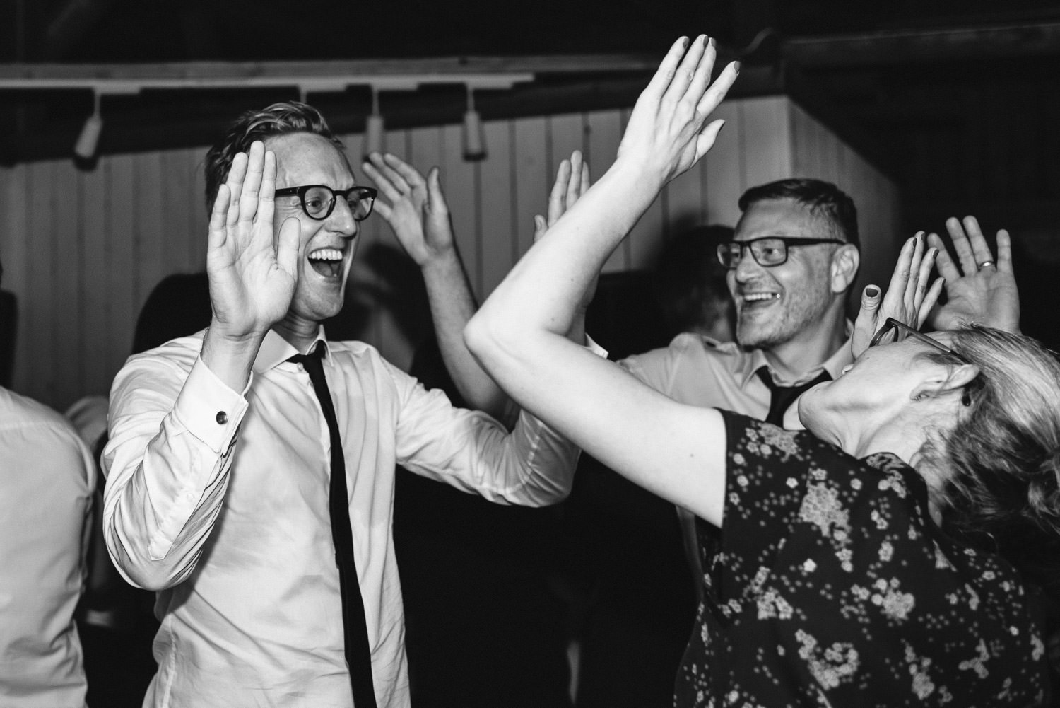 dancing in Norwegian Barn Wedding by norway destination wedding photographer the shannons photography