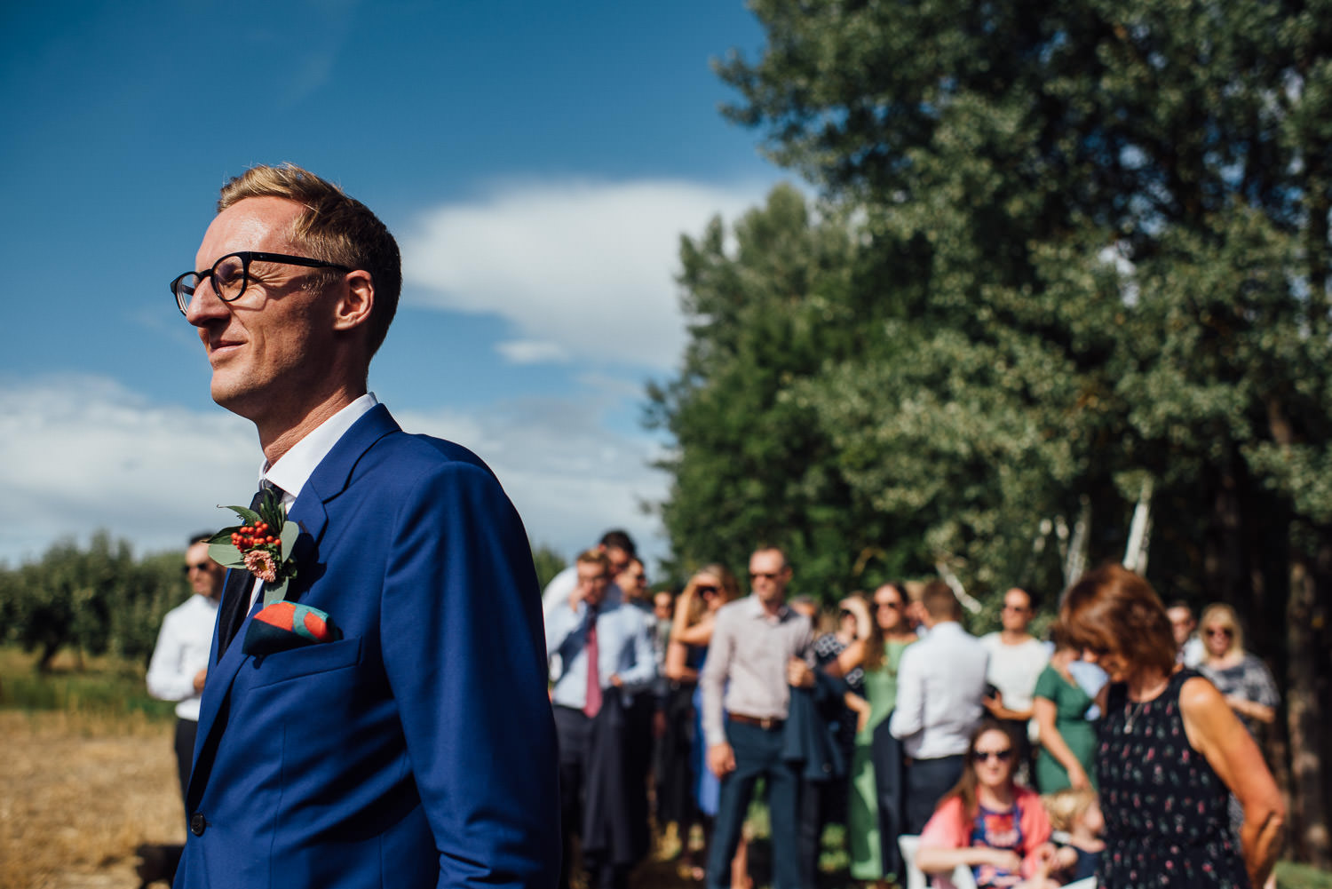 Paul smith suit Norwegian Barn Wedding by norway destination wedding photographer the shannons photography