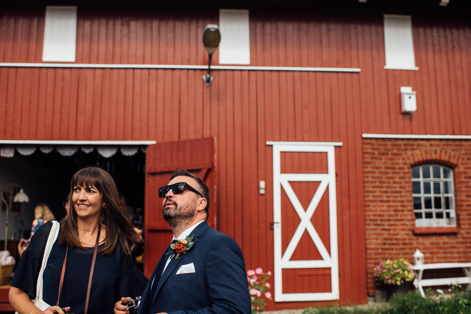 wedding guests in Norwegian Barn Wedding by norway destination wedding photographer the shannons photography