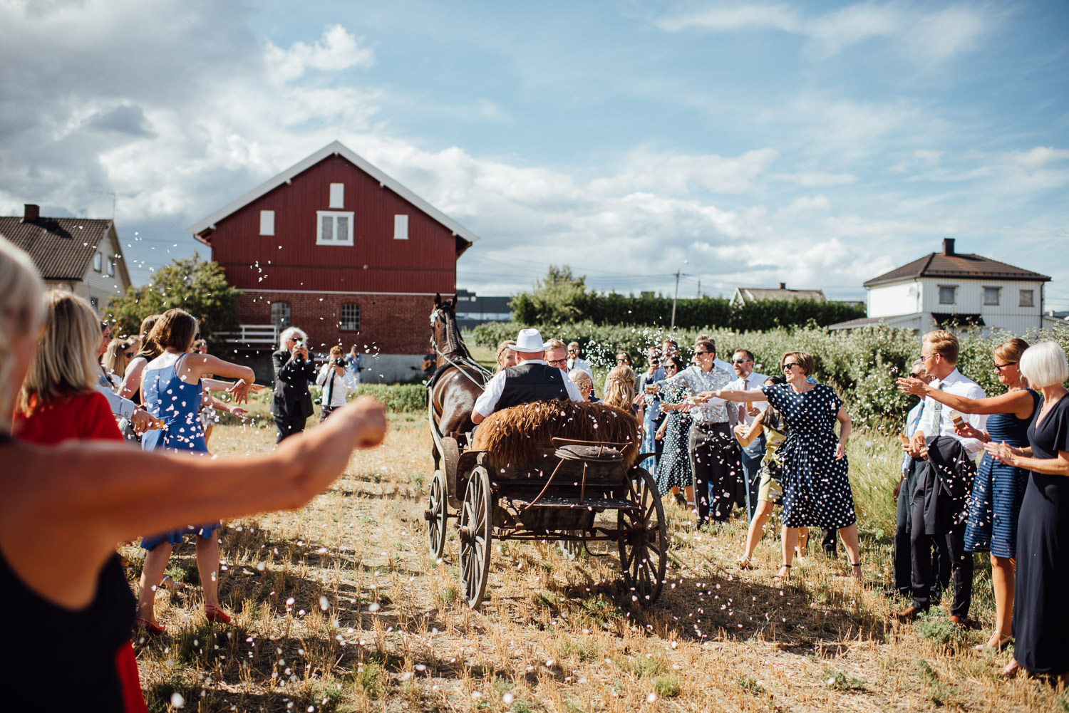 Confetti throw in Norwegian Barn Wedding by norway destination wedding photographer the shannons photography