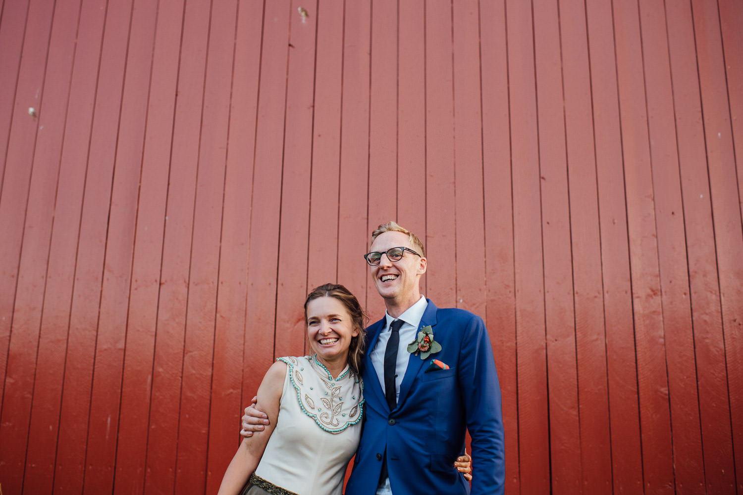 Red timber barn in Norwegian Barn Wedding by norway destination wedding photographer the shannons photography