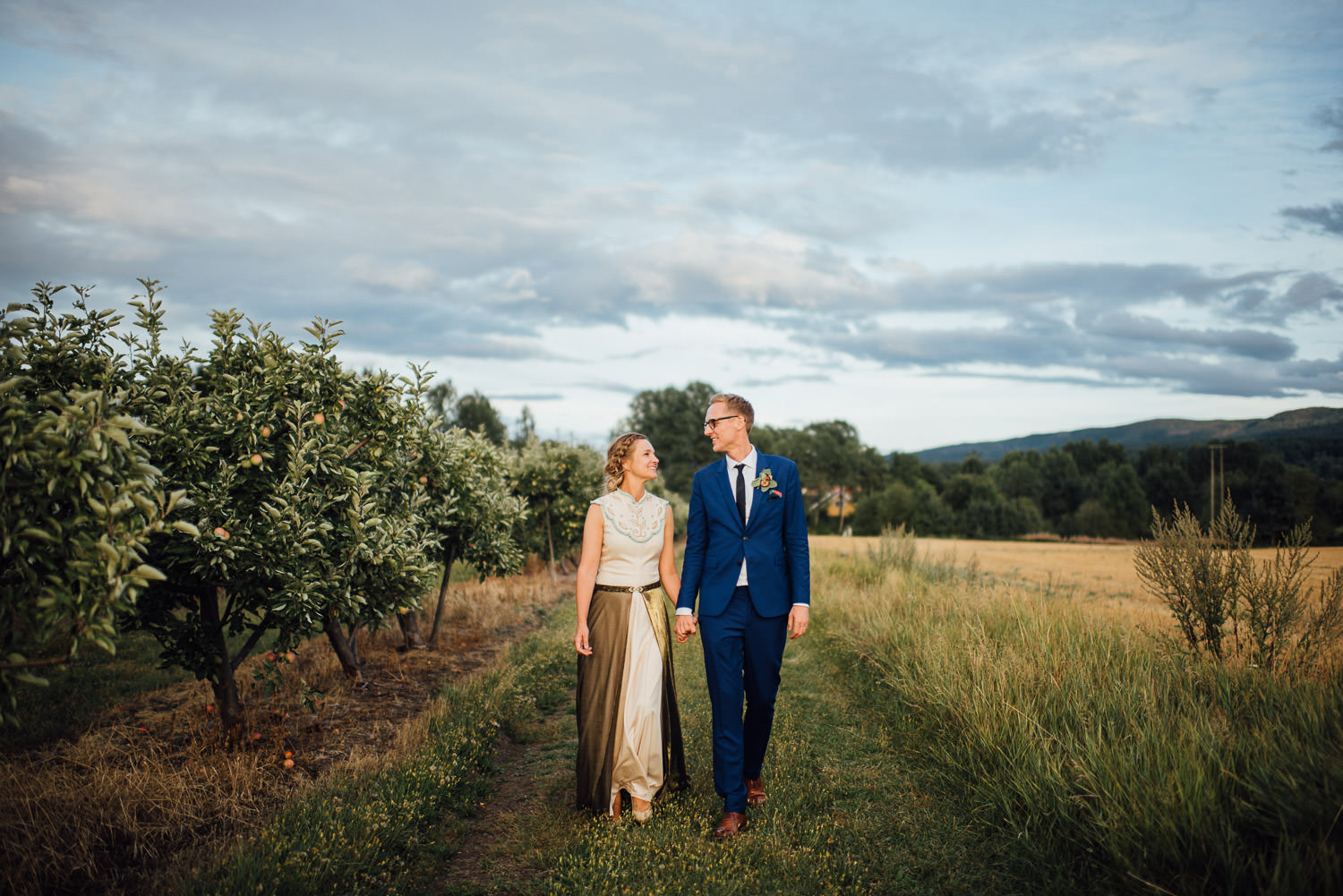 couples walk in Norwegian Barn Wedding by norway destination wedding photographer the shannons photography