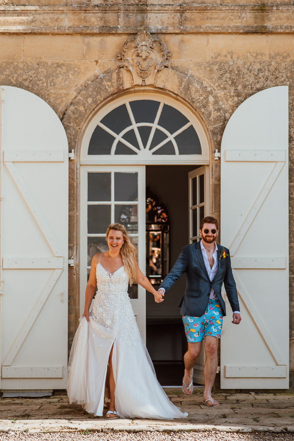 bride and groom entrance chateau de lacoste wedding