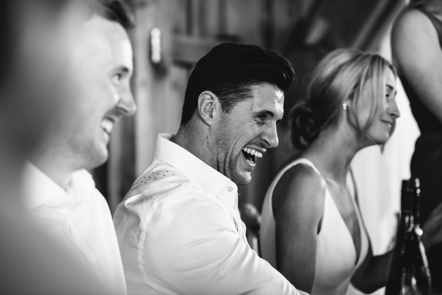 groom laughing in french chateau wedding