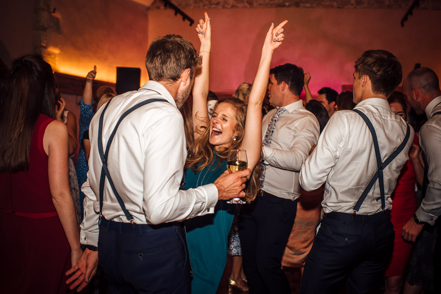 guests dancing at oxleaze barn wedding
