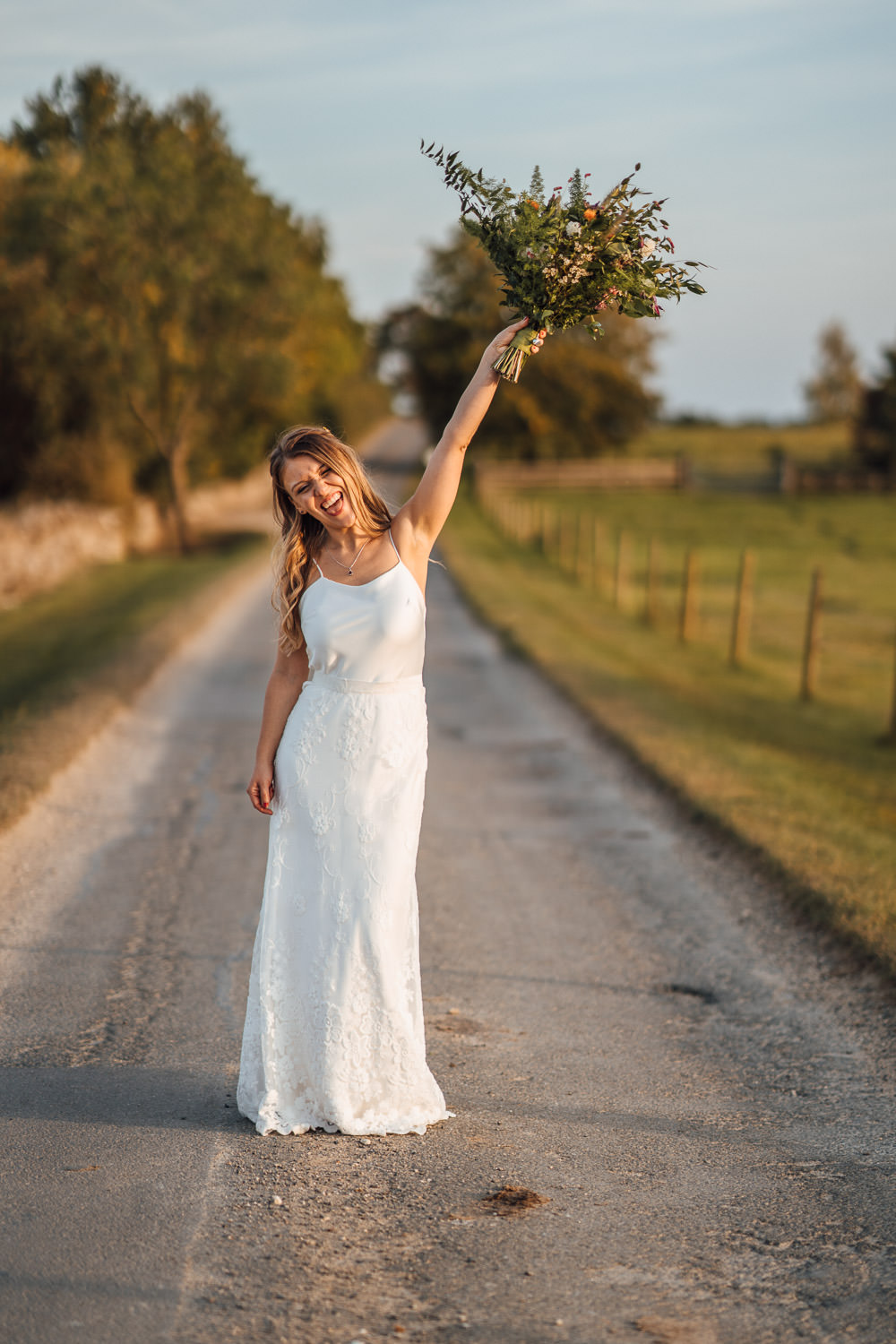 bride in halfpenny london wedding dress with rustic wildflower bouquet