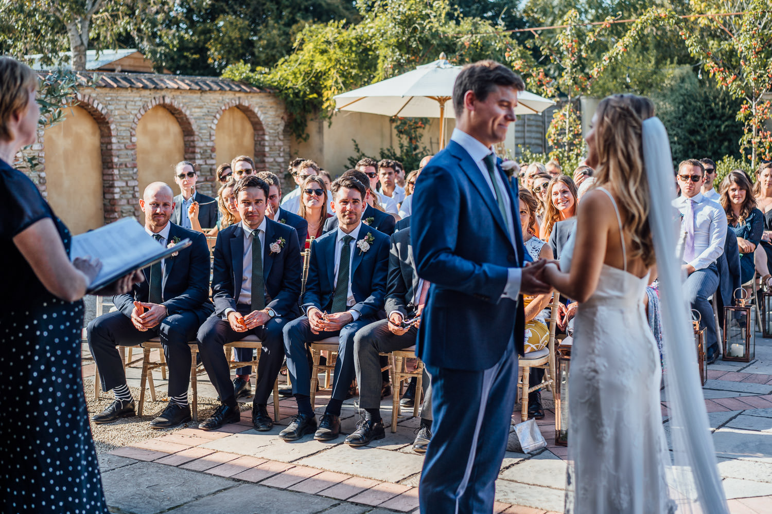 wedding ceremony in oxleaze barn wedding by cotswolds wedding photographer the shannons photography
