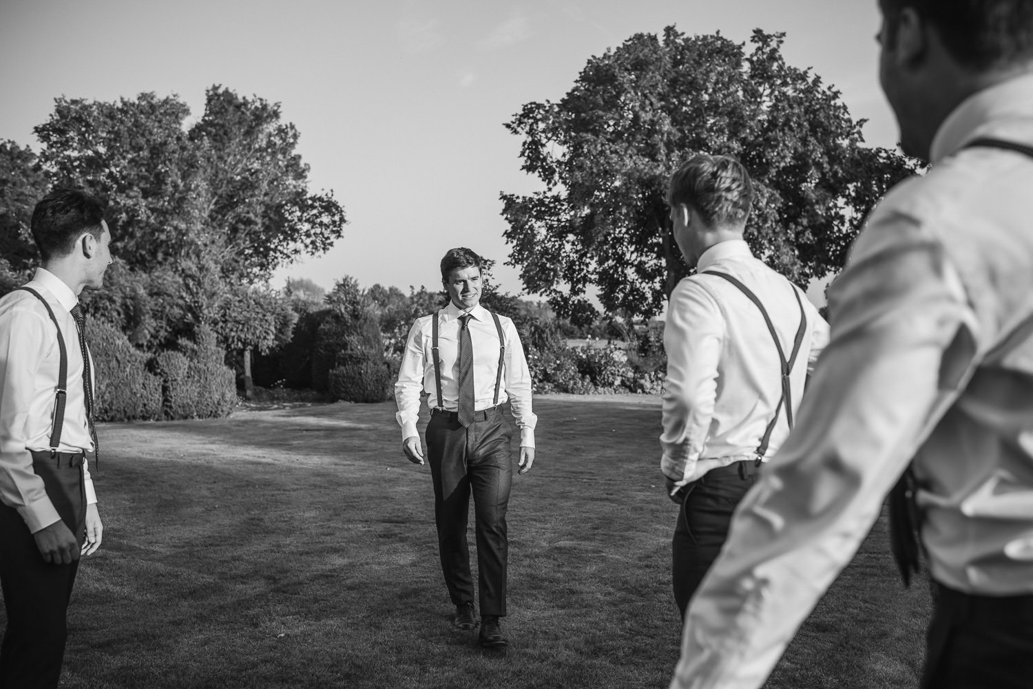 groomsmen pictures in oxleaze barn wedding