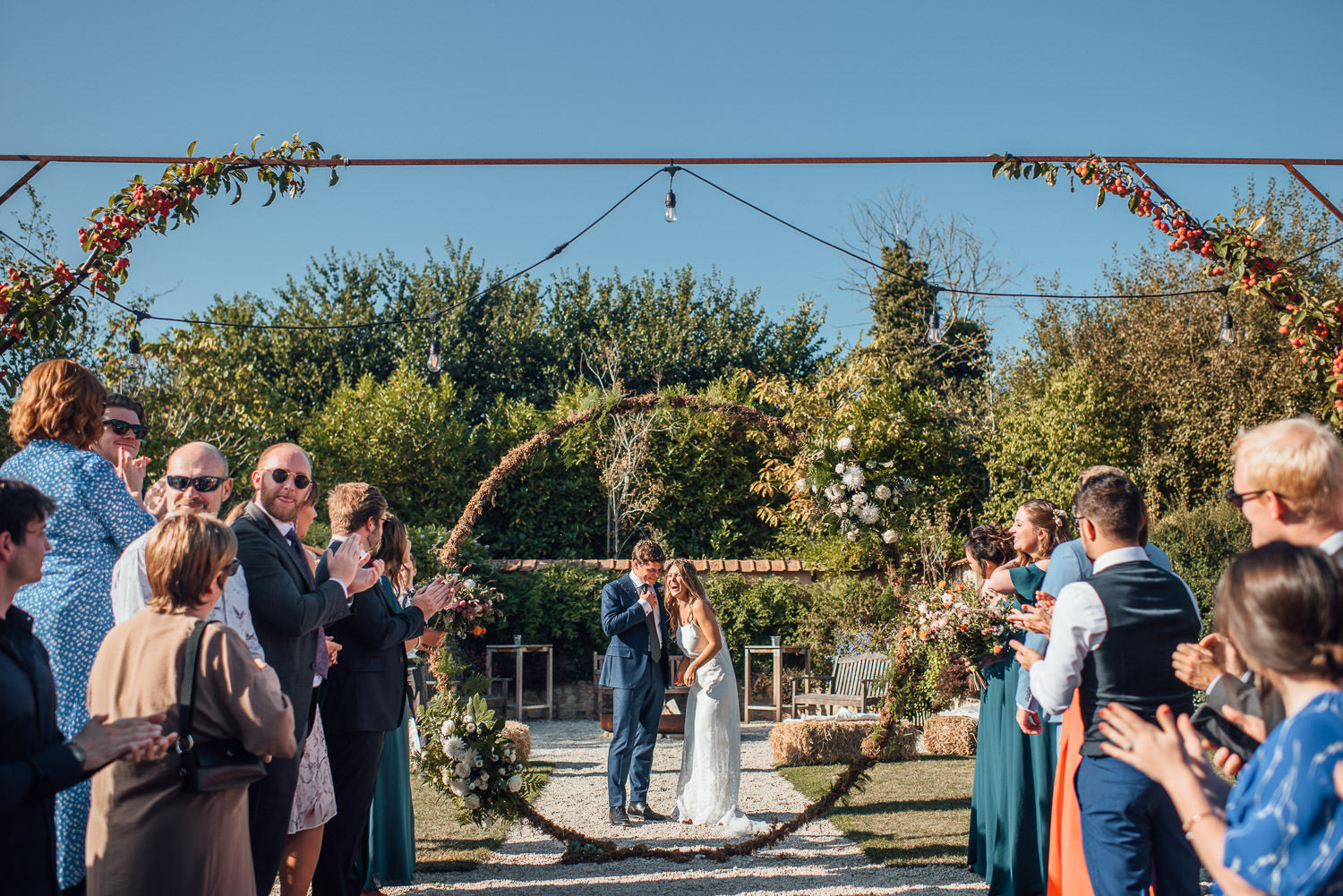 floral moon gate in oxleaze barn wedding