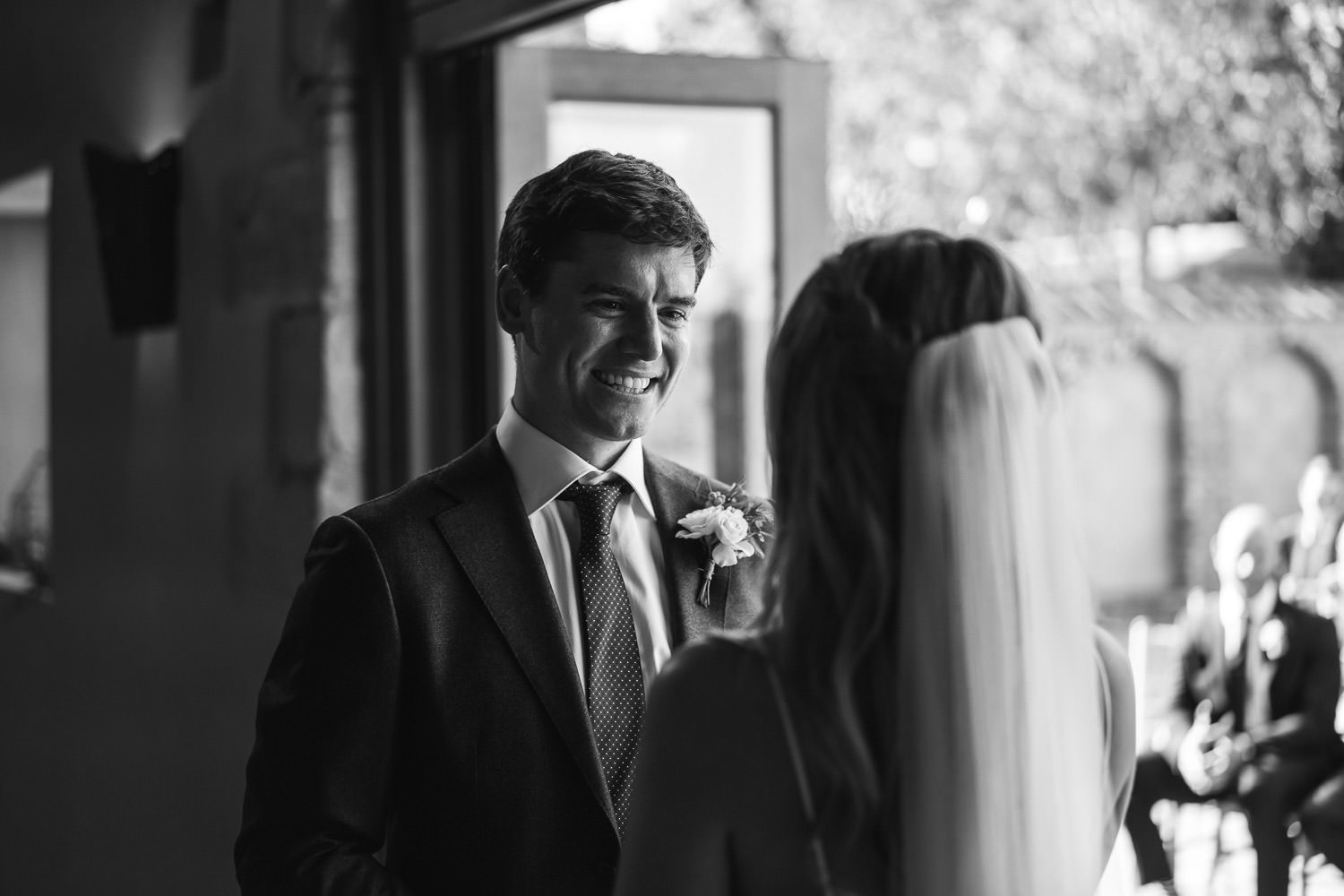 wedding vows in oxleaze barn wedding by london wedding photographer