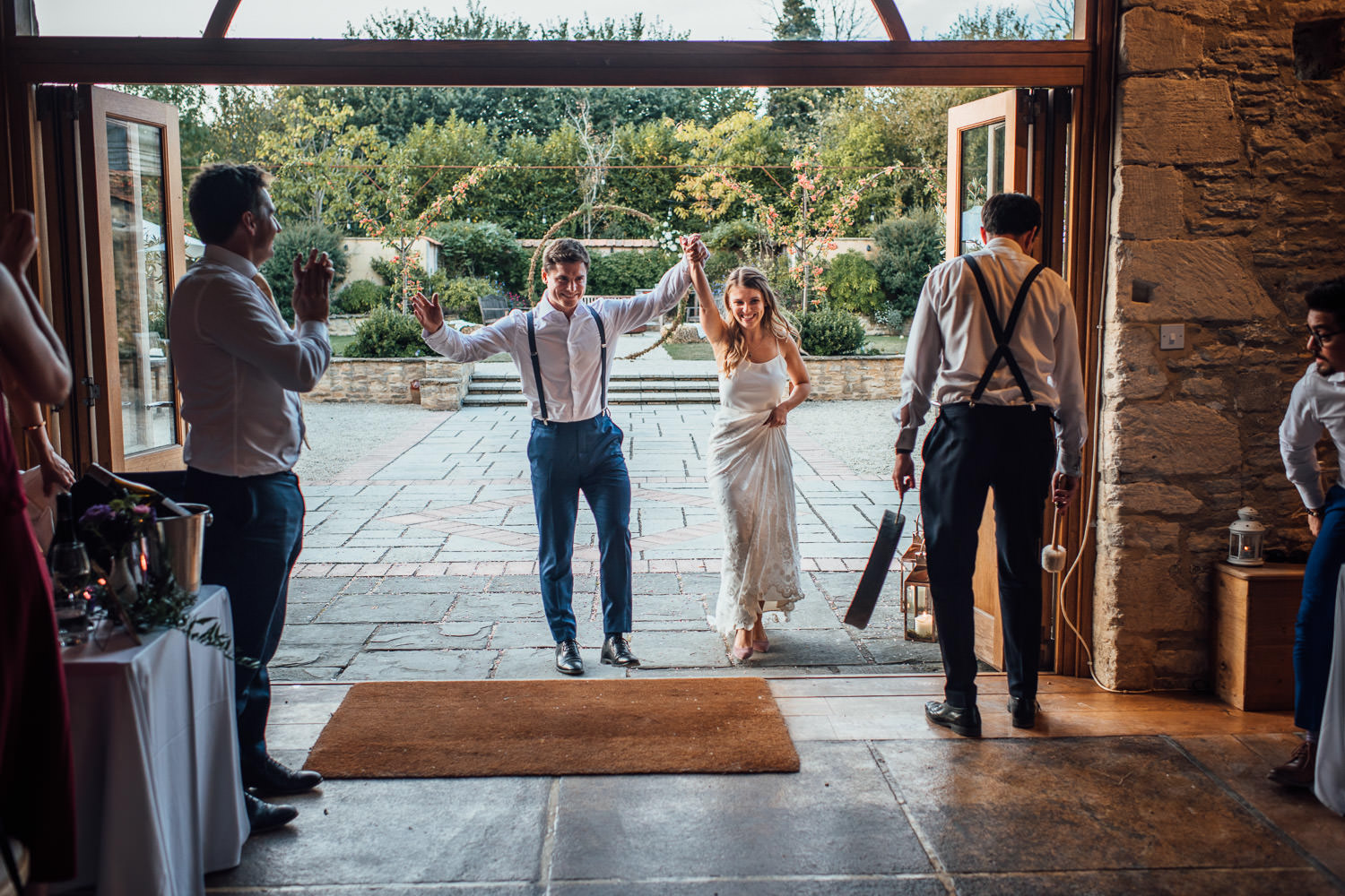 wedding reception in oxleaze barn wedding by cotswolds wedding photographer the shannons photography