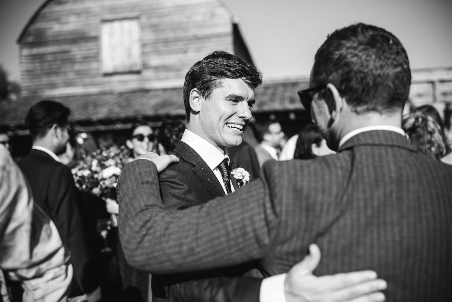guests laughing in oxleaze barn wedding
