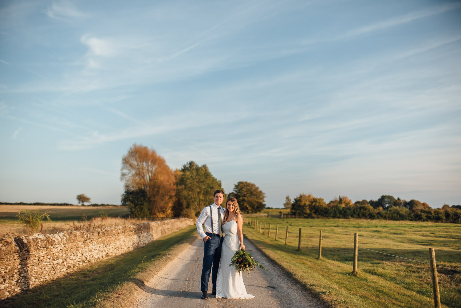 couple portraits in oxleaze barn wedding