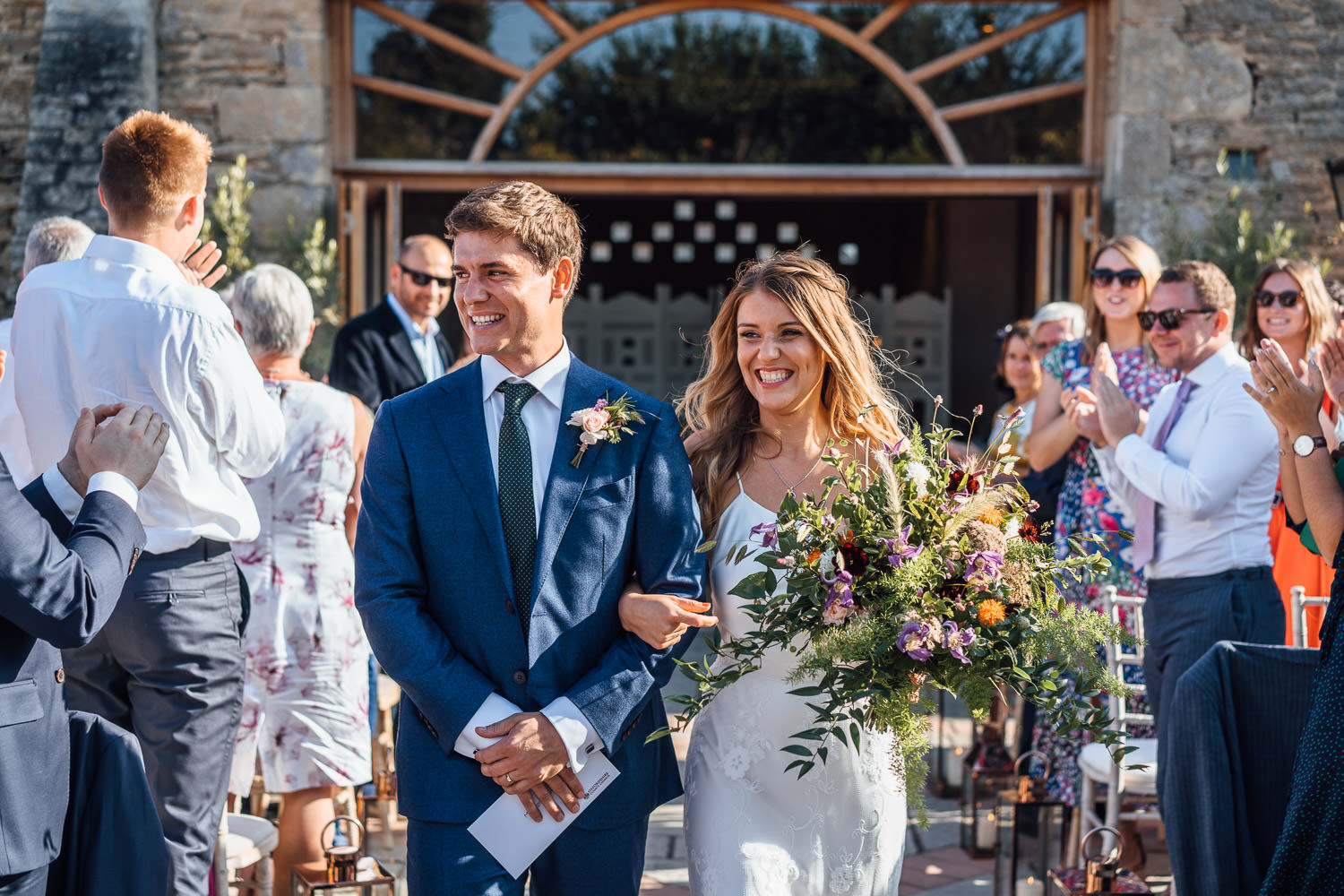 cool rustic floral bridal bouquet in oxleaze barn wedding